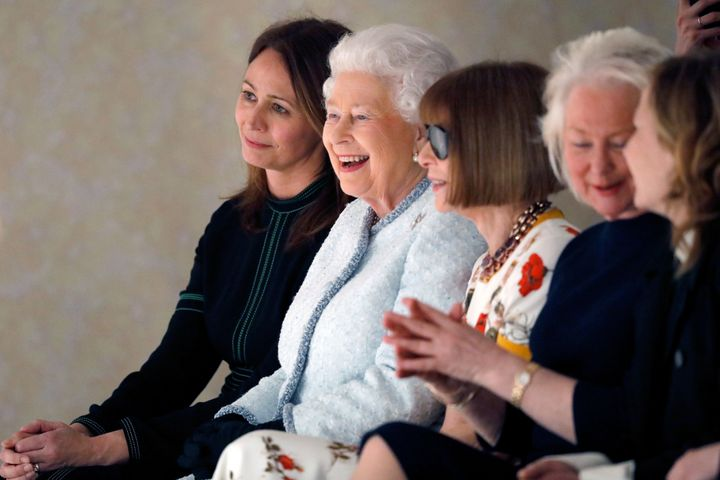 From left, British Fashion Council chief executive Caroline Rush, Queen Elizabeth II and Vogue Editor-in-Chief Anna Wintour attend the Richard Quinn show during London Fashion Week on Feb. 20, 2018, in London.