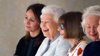 LONDON, ENGLAND - FEBRUARY 20: (L-R) Chief Executive of the British Fashion Council Caroline Rush, Queen Elizabeth II and Anna Wintour attend the Richard Quinn show during London Fashion Week February 2018 on February 20, 2018 in London, England.  (Photo by Tristan Fewings/BFC/Getty Images)