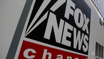 A Fox News channel sign is seen on a television vehicle outside the News Corporation building in New York City, in New York, U.S. November 8, 2017. REUTERS/Shannon Stapleton