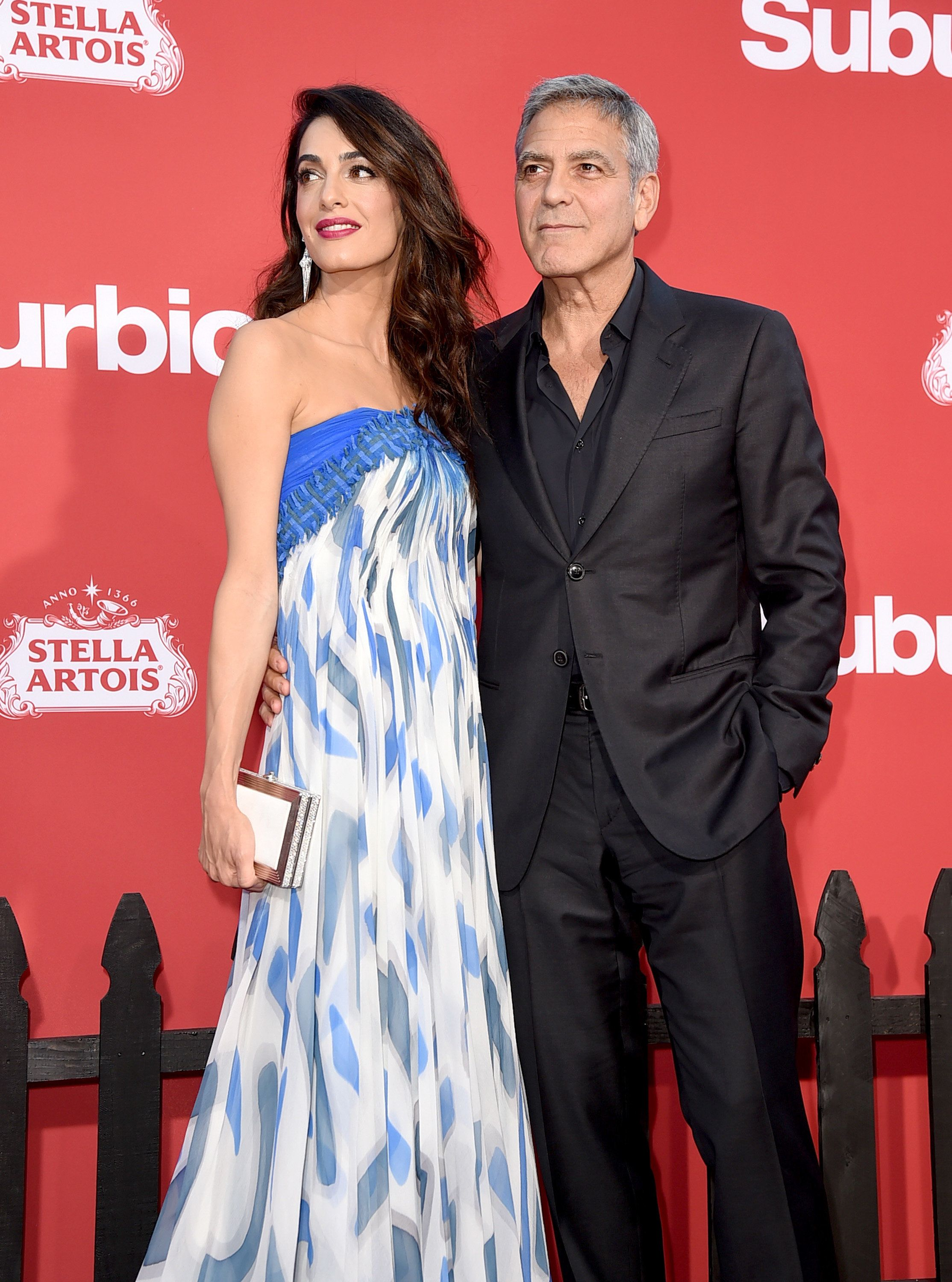 LOS ANGELES, CA - OCTOBER 22:  Executive producer George Clooney (R) and his wife Amal Clooney arrive at the premiere of Paramount Pictures' 'Suburbicon' at the Village Theatre on October 22, 2017 in Los Angeles, California.  (Photo by Kevin Winter/Getty Images)