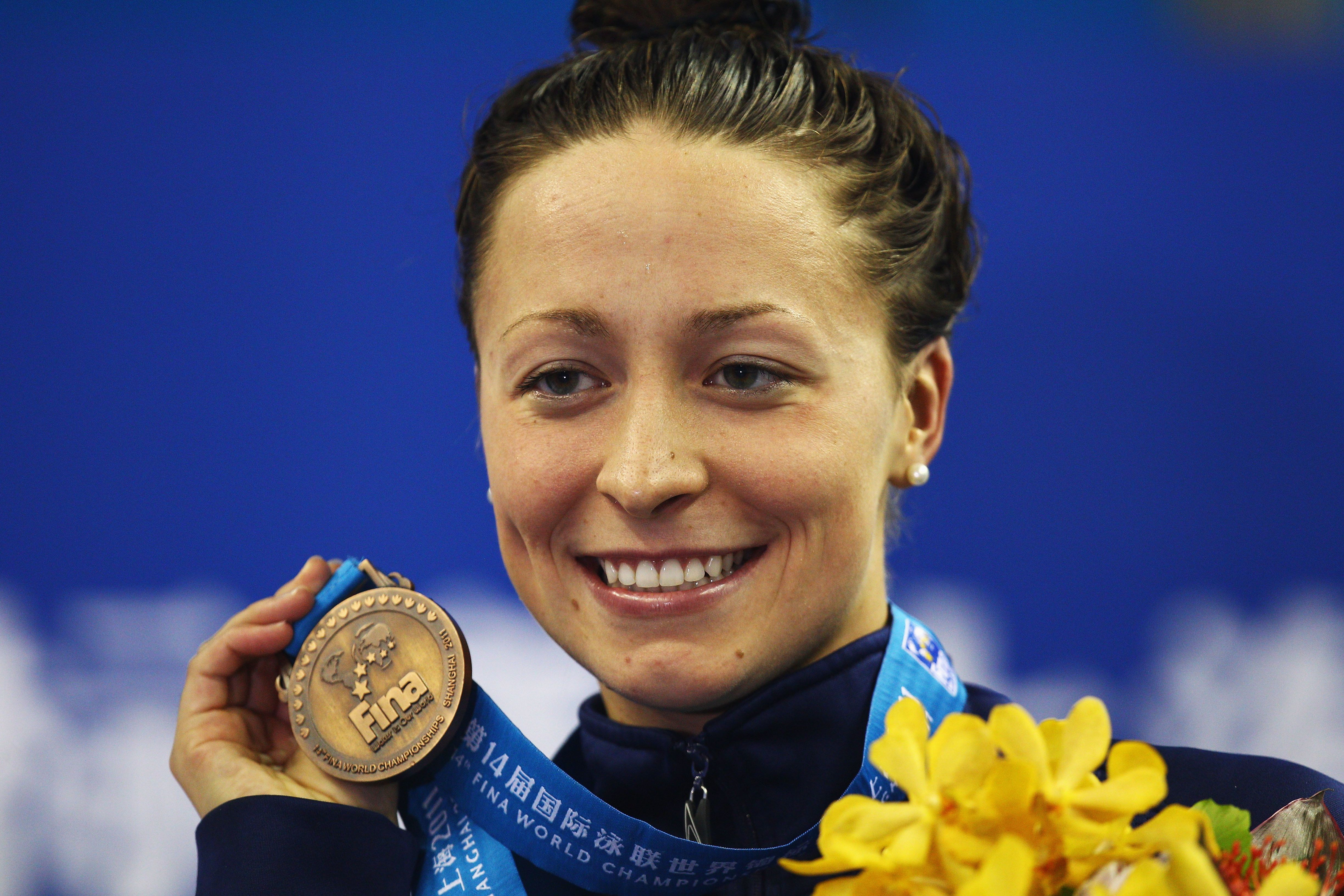 Ariana Kukors holds up her bronze medal for the women's 200-meter individual medley final during the 14th FINA World Champion