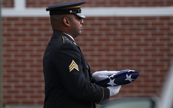 An American flag is carried into the funeral for Alaina Petty on February 19, 2018 in Coral Springs, Florida.