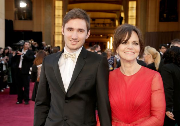Sam Greisman (L) and Sally Field arrive at the Oscars in