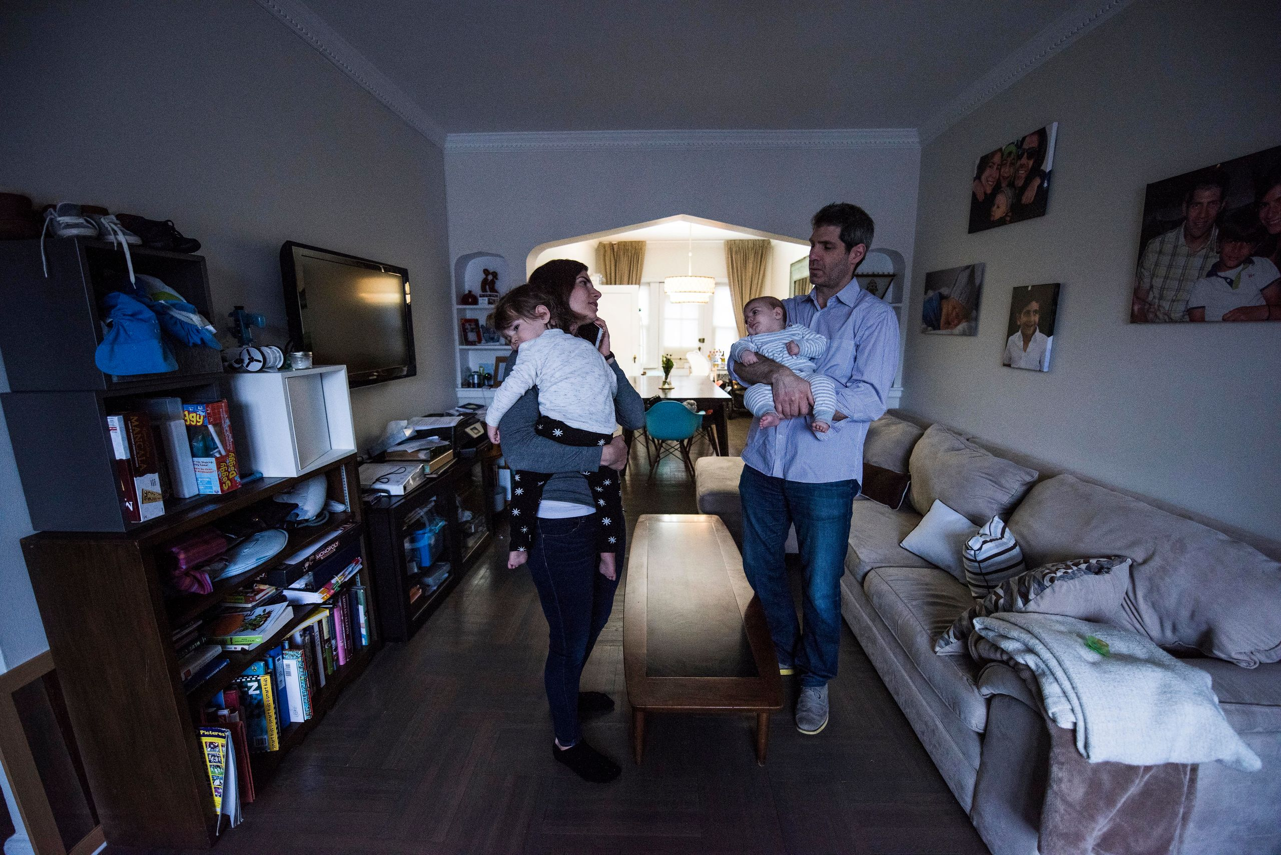 Jennie and Gary Landsman hold Benny and Josh in the living room of their Brooklyn, New York, home. When both parents are carr
