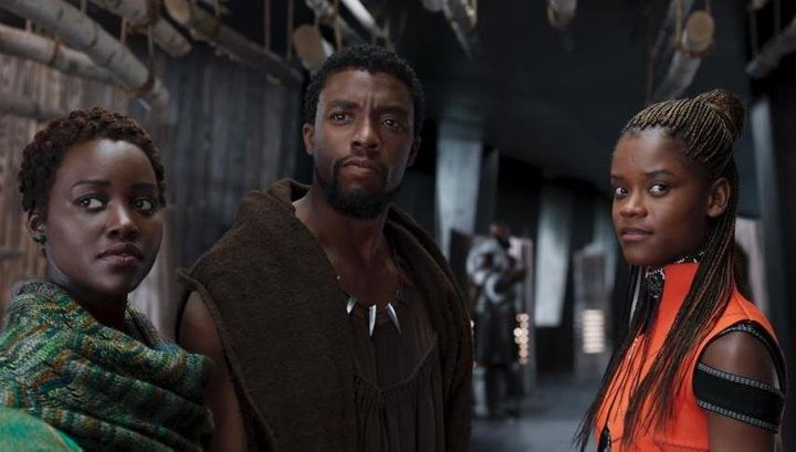 """Left to right: Nakia (Lupita Nyong'o), King T'Challa (Chadwick Boseman) and Princess Shuri (Letitia Wright) stand side by side in """"Black Panther."""""""
