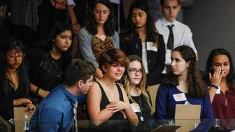 Students from Marjory Stoneman Douglas High School and those supporting them react as they watch the Florida House of Representatives vote down a procedural move to take a bill banning assault weapons out of committee and bring it to the floor for a vote on February 20, 2018 in Tallahassee, Florida, U.S. following last week's mass shooting on their campus.    REUTERS/Colin Hackley
