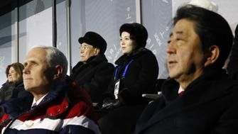 PYEONGCHANG-GUN, SOUTH KOREA - FEBRUARY 09:  Kim Yong Nam, top left, president of the Presidium of North Korean Parliament, and Kim Yo Jong, sister of North Korean leader Kim Jong Un, top right, sit behind U.S. Vice President Mike Pence, bottom left, and Japanese Prime Minister Shinzo Abe, bottom right, as they watch the opening ceremony of the 2018 Winter Olympics at PyeongChang Olympic Stadium on February 9, 2018 in Pyeongchang-gun, South Korea.  (Photo by Patrick Semansky - Pool /Getty Images)