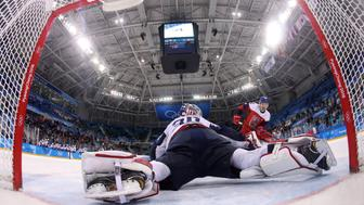Ice Hockey - Pyeongchang 2018 Winter Olympics - Men's Quarterfinal Match - Czech Republic v U.S. - Gangneung Hockey Centre, Gangneung, South Korea - February 21, 2018 - Petr Koukal of the Czech Republic scores the winning goal in a shootout past goalie Ryan Zapolski of U.S. REUTERS/Ronald Martinez/Pool