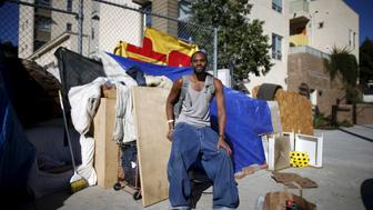 "Dontray Williams, 28, poses for a portrait by the tent in which he lives on the streets of Los Angeles, California, United States, November 13, 2015. Williams has been periodically homeless for around five years. Being homeless ""takes the fun out of life"" Williams said, he hopes to find a job and an apartment. REUTERS/Lucy Nicholson PICTURE 5 OF 17 - SEARCH ""NICHOLSON MOTORHOME"" FOR ALL IMAGES TPX IMAGES OF THE DAY"