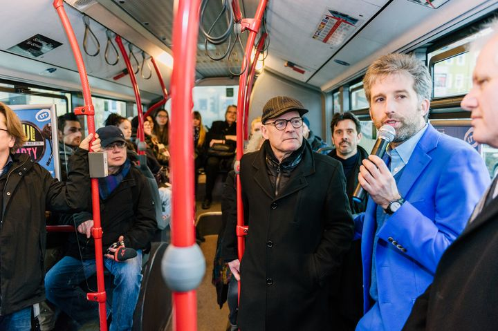 Tübingen Mayor Boris Palmer speaking on one of the city's buses. The city is trying out a program where public transit i