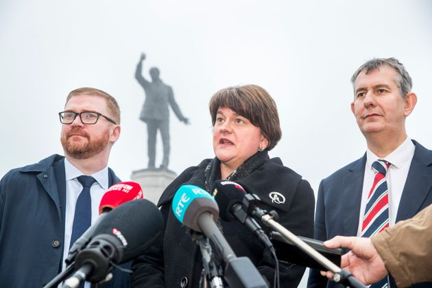 DUP leader Arlene Foster, with party colleagues Simon Hamilton and Edwin Poots (right), speaks with media...