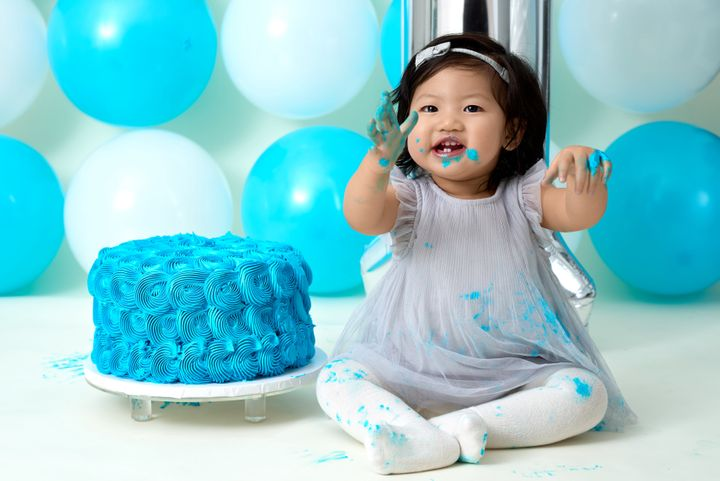 """For their first birthdays, many kids arehaving their cake and eating it, too, by """"smashing"""" it."""