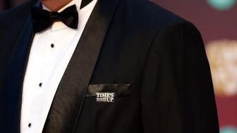 A guest on the red carpet wears a Time's Up pin badge at the EE British Academy Film Awards held at the Royal Albert Hall, Kensington Gore, Kensington, London.
