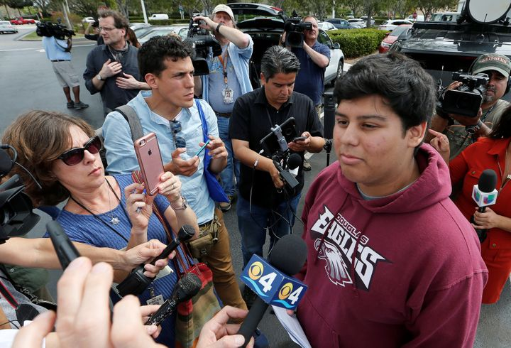 Marjory Stoneman Douglas High School student Jose Iglesias is questioned by reporters Tuesday before joining other students on buses to travel to Tallahassee, Florida, to meet with legislators.