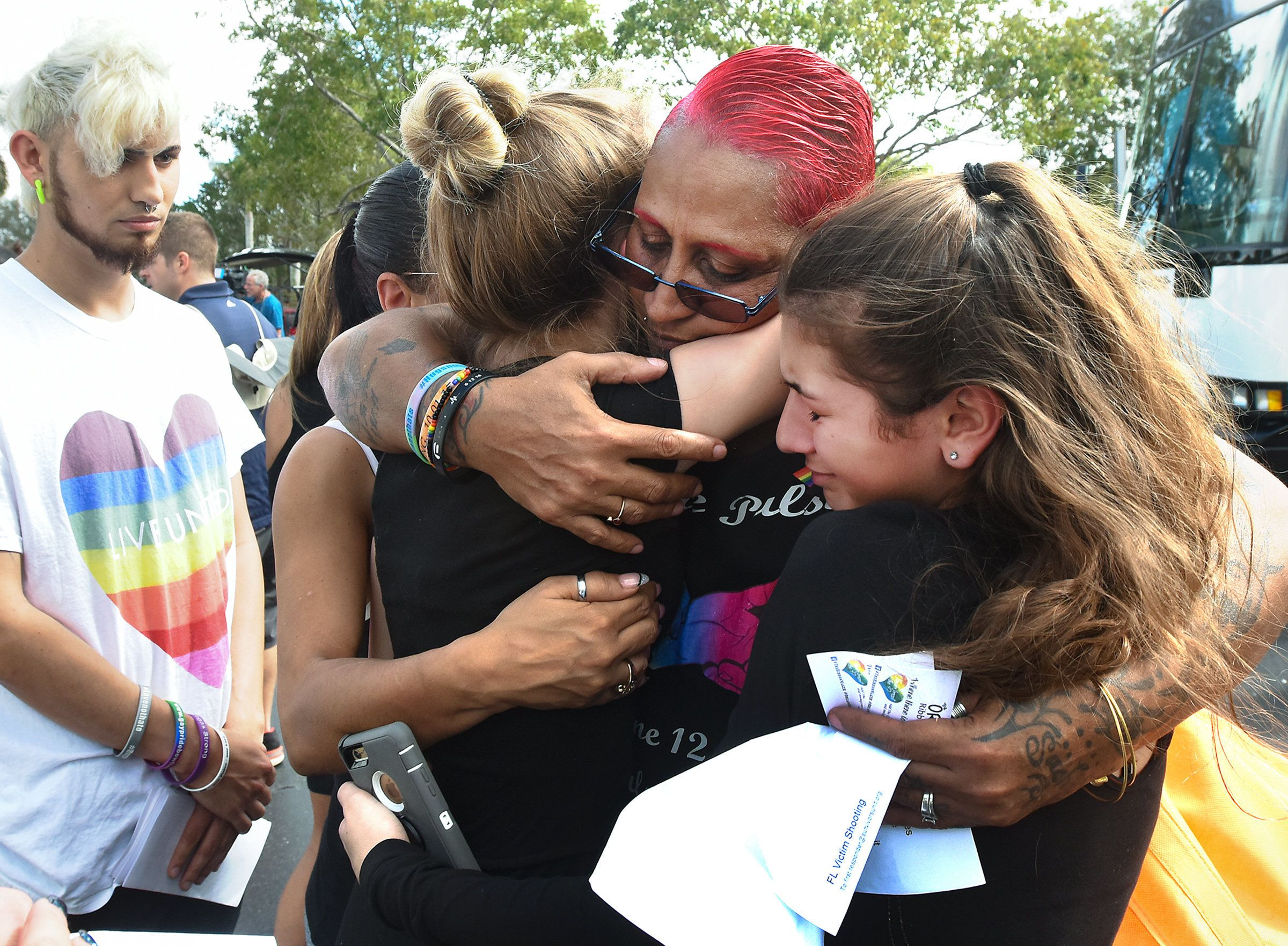 Pulse nightclub survivor India Goodman hugs and comforts students before they left for Tallahassee on Feb. 20, 2018.