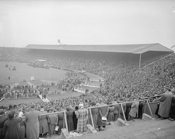 Crowds listen with rapt attention to a Graham sermon at Wembley Stadium in London on May 16, 1955.