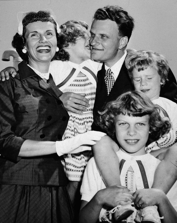 Graham embraces his family upon his return from his 'Crusade for Christ' tour in the mid-1950s. Clockwise from left: His