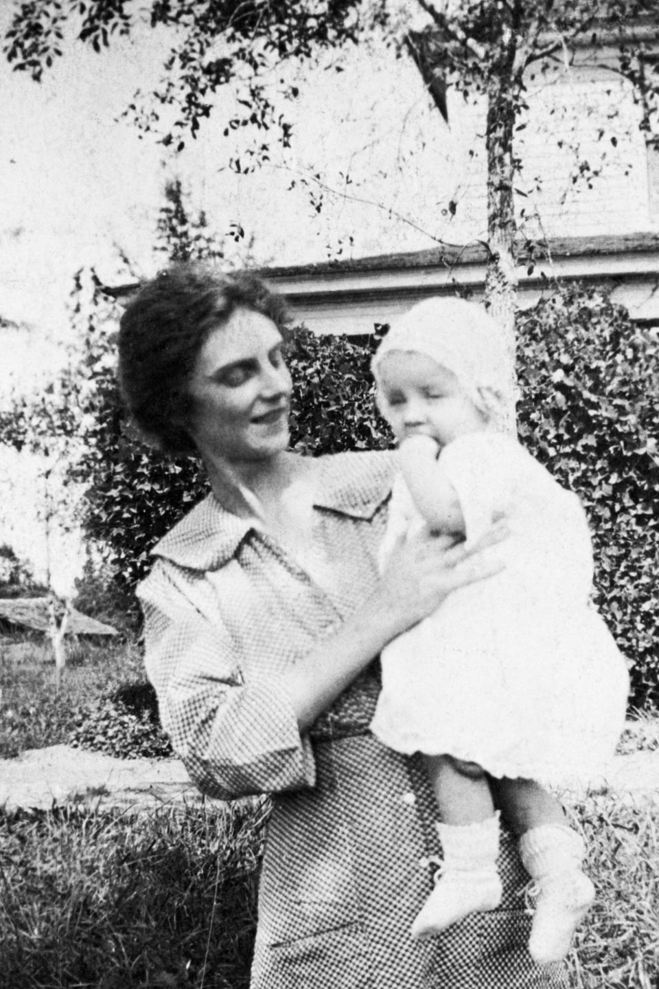 Future evangelist Billy Graham at six months old in this photograph with his mother, Mrs. Morrow Graham. He was born on