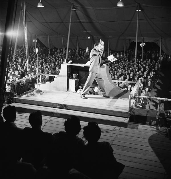 As a young Baptist evangelist, Graham preaches to a large crowd in Los Angeles, California, in 1949. The event drew thou