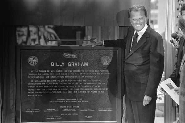 Graham unveils the plaque commemorating the site of his first crusade that launched his career. At the ceremonies, he preache
