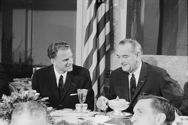Graham and U.S. President Lyndon B Johnson talk together at the Annual Presidential Prayer Breakfast in Washington, D.C., on&