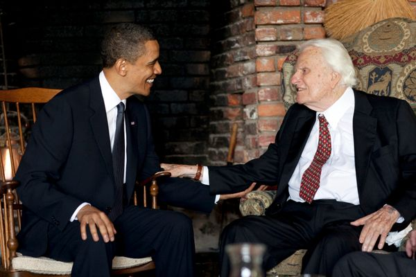 President Barack Obama meets with Graham at his house in Montreat, North Carolina, in this handout photograph taken and relea