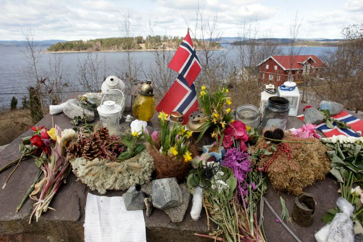 Norway's national flags, flowers and candles are arranged at a memorial site northwest of Oslo that commemorates the 69 peopl