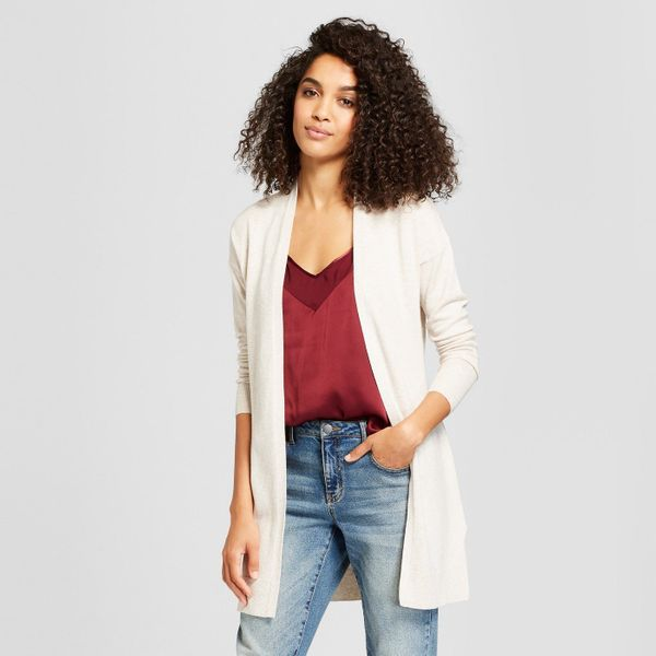 """Cardigans or throw-over sweaters will keep your capsule wardrobe seamlessly moving from one season to the next. Get <a href="""""""