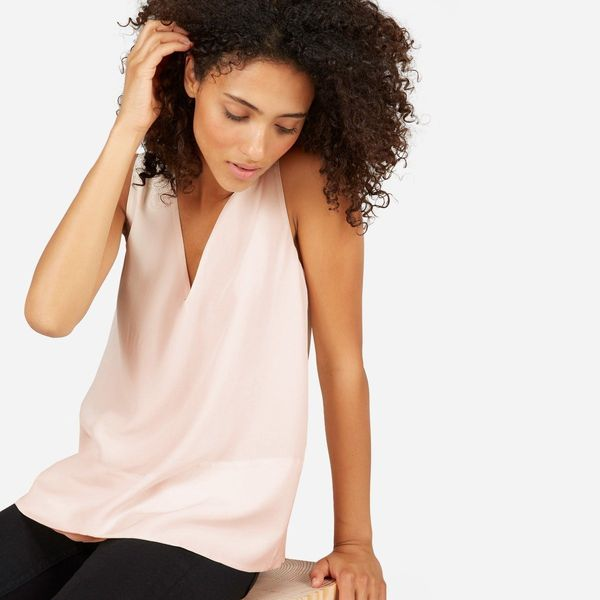 If you need a top to instantly take your look from day to night, invest in a cute tank with flirty detailing like a v-neck. W
