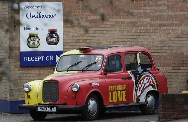 A branded taxi stands outsideUnilever's Marmite factory in Burton upon