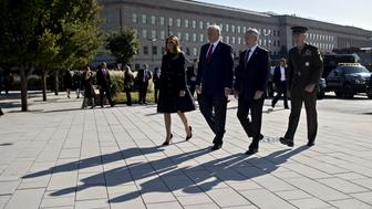 General Joseph Dunford, chairman of the Joint Chiefs of Staff, from right, Jim Mattis, U.S. secretary of defense, U.S. President Donald Trump and U.S. First Lady Melania Trump participate in a ceremony to commemorate the September 11, 2001 terrorist attacks, at the Pentagon in Washington, D.C., U.S., on Monday, Sept. 11, 2017. Trump is presiding over his first 9/11 commemoration on the 16th anniversary of the terrorist attacks that killed nearly 3,000 people when hijackers flew commercial airplanes into New York's World Trade Center, the Pentagon and a field near Shanksville, Pennsylvania. Photographer: Andrew Harrer/Bloomberg via Getty Images