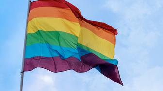 rainbow flag against the blue sky, symbol of tolerance and acceptance, diversity, hope and longing. The colors of this flag are specially for LGBT (Lesbian, Gay, Bisexual, Transgender) Pride