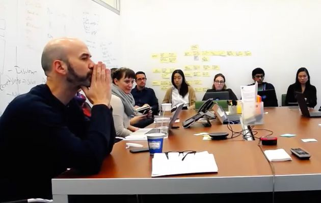 James Bennet, at left, meets with a group of New York Times employees in December. A source provided...
