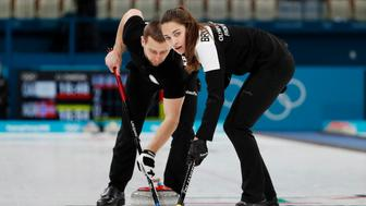 Curling – Pyeongchang 2018 Winter Olympics – Mixed Doubles Bronze Medal Match - Olympic Athletes from Russia v Norway - Gangneung Curling Center - Gangneung, South Korea – February 13, 2018 - Alexander Krushelnitsky and Anastasia Bryzgalova, Olympic athletes from Russia, sweep. Picture taken February 13, 2018. REUTERS/Cathal McNaughton