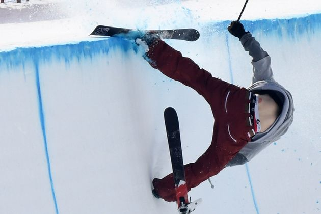 Torin Yater-Wallace of the United States crashes into the lip of the halfpipe at the Games in