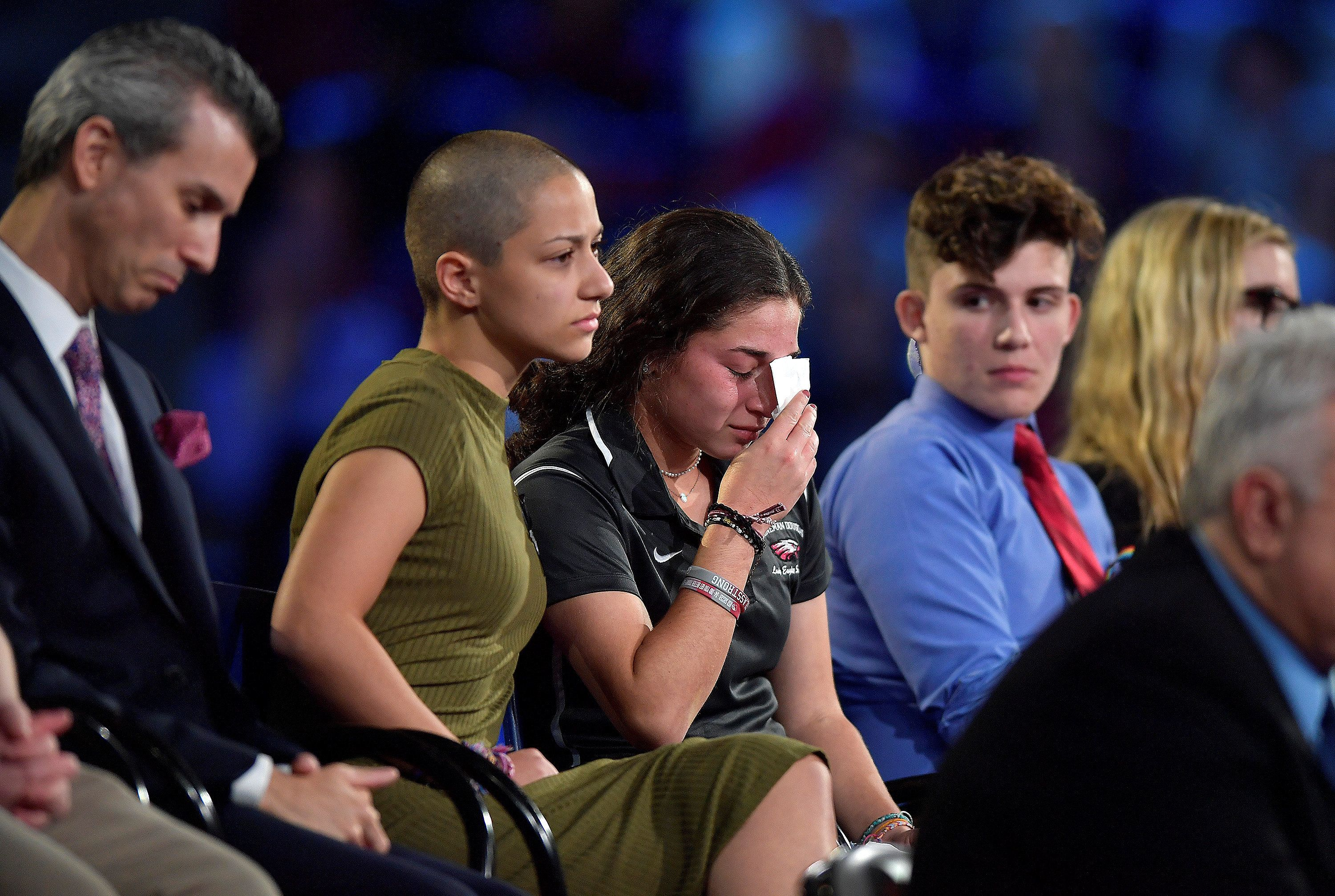 Marjory Stoneman Douglas High School student Emma Gonzalez comforts a classmate during a CNN town hall meeting, at the BB&T Center, in Sunrise, Florida, U.S. February 21, 2018.  REUTERS/Michael Laughlin/Pool