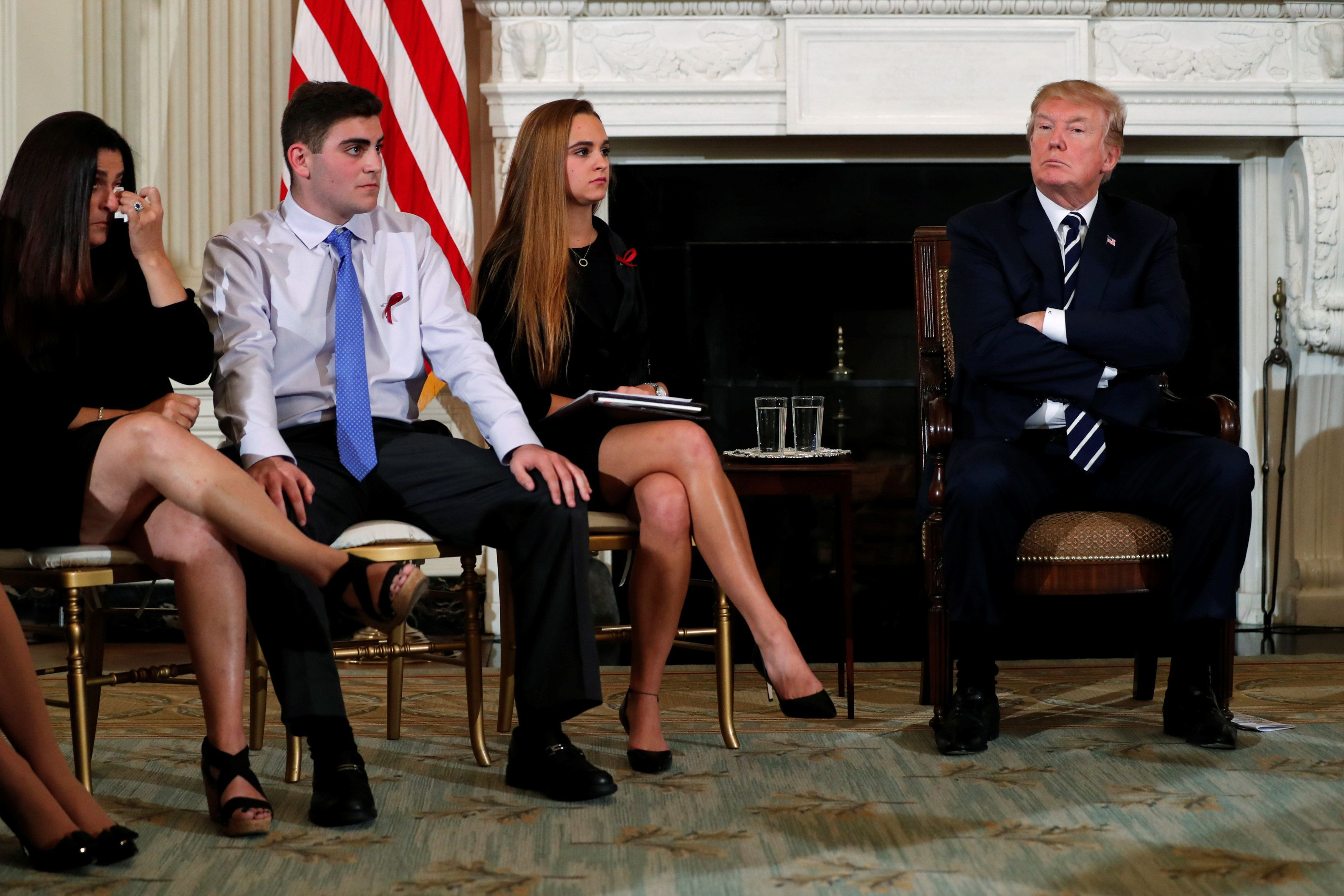 Parent Melissa Blank (L) and Marjory Stoneman Douglas High School shooting surviving students Jonathan Blank (2nd L) and Julia Cordover (2nd R) attend with other survivors and the families of victims a listening session held by U.S. President Donald Trump to discuss school safety and shootings, at the White House in Washington, U.S., February 21, 2018. REUTERS/Jonathan Ernst