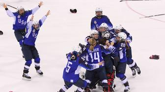 GANGNEUNG, SOUTH KOREA - FEBRUARY 22:  The United States celebrates after defeating Canada 3-2 in a shootout to win the Women's Gold Medal Game on day thirteen of the PyeongChang 2018 Winter Olympic Games at Gangneung Hockey Centre on February 22, 2018 in Gangneung, South Korea.  (Photo by Harry How/Getty Images)