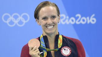 USA's Dana Vollmer poses on the podium after she won bronze in the Women's 100m Butterfly Final during the swimming event at the Rio 2016 Olympic Games at the Olympic Aquatics Stadium in Rio de Janeiro on August 7, 2016.   / AFP / CHRISTOPHE SIMON        (Photo credit should read CHRISTOPHE SIMON/AFP/Getty Images)