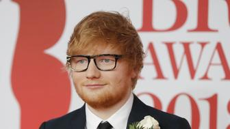 British singer-songwriter Ed Sheeran poses on the red carpet on arrival for the BRIT Awards 2018 in London on February 21, 2018. / AFP PHOTO / Tolga AKMEN / RESTRICTED TO EDITORIAL USE  NO POSTERS  NO MERCHANDISE NO USE IN PUBLICATIONS DEVOTED TO ARTISTS        (Photo credit should read TOLGA AKMEN/AFP/Getty Images)