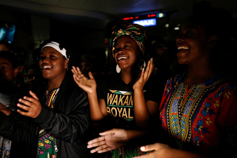 """Ron Clark Academy seventh-grader Nevaeh Williams, center, joins classmates in singing a song after watching""""Black Panth"""