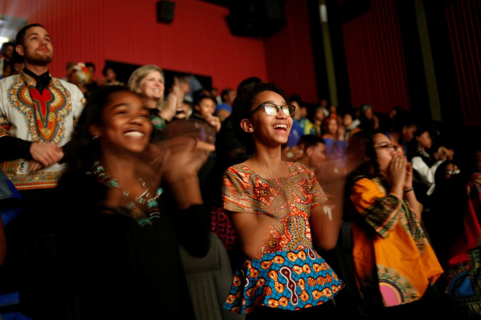 Ron Clark Academysixth-grader Naima Johnson, 12, center, joins classmates in applauding at the end of the film.