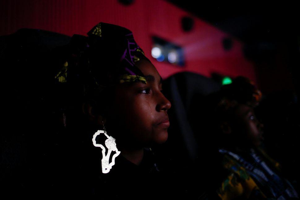 "Destiny Ellington, 12, sheds a tearwhile watching ""Black Panther."""