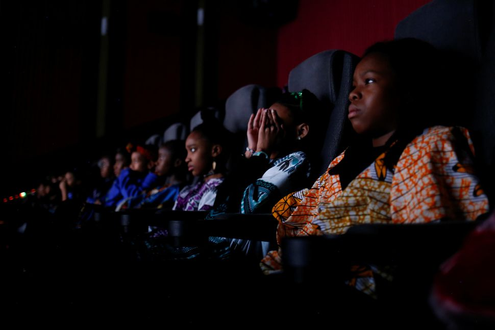 "Ron Clark Academy students watch the film ""Black Panther"" at Atlantic Station theaters in Atlanta on Feb. 21, 2018."