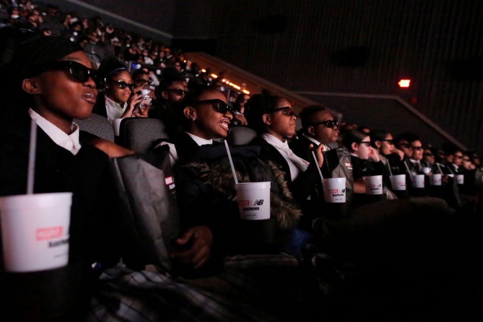 "A group of students from the Capital Preparatory Harlem School watch the film ""Black Panther"" on its opening night at the AMC"