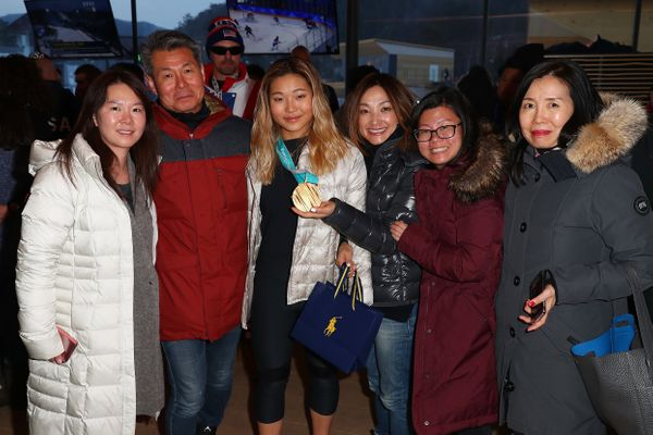 Chloe Kim poses for a photo with her parents and other family members onFeb. 14, just days after winning gold in the sn