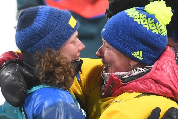 Hanna Öberg and her mother celebrate after shewins gold in the women's 15km individual biathlon event onFeb.