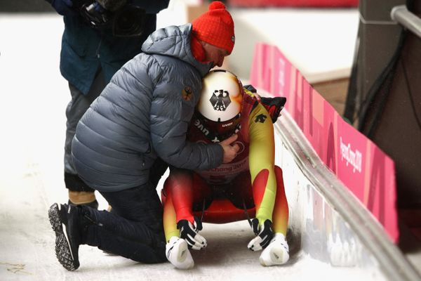 Felix Loch is consoled by his father, Norbert Loch, after finishing fifth overallin theluge men's singles on&nbsp