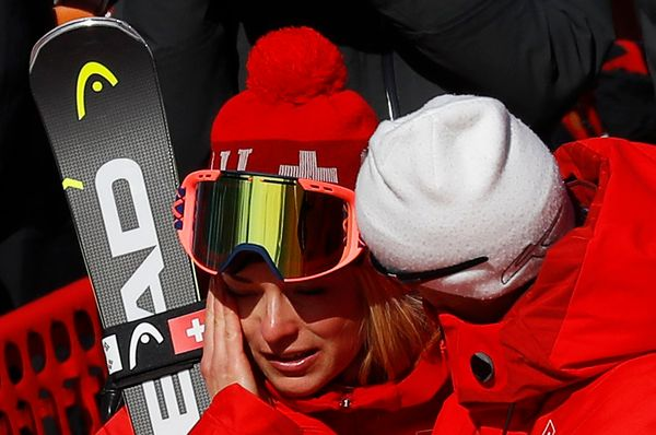 Alpine skier Lara Gut is comforted byher father, Pauli, after the women'ssuper-G event.