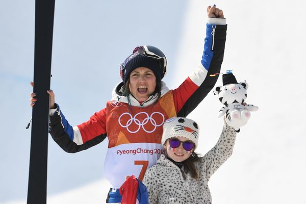 Marie Martinod and her daughter celebrate on the podium during themedal ceremonyfor the women's ski halfpipe fina